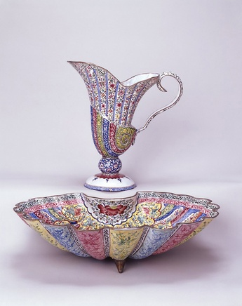 A CHINESE CANTON ENAMEL HELMET SHAPED EWER AND SHELL SHAPED BASIN, First half of the eighteenth century