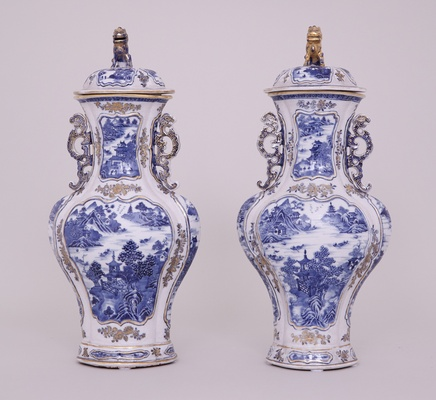 A PAIR OF CHINESE BLUE AND WHITE NANKIN VASES AND COVERS, Qianlong (1736-1795)
