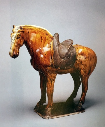 A GLAZED POTTERY FIGURE OF A HORSE, Tang Dynasty